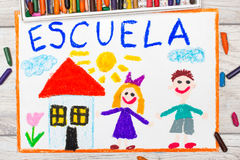 Photo of  colorful drawing: Spanish word SCHOOL. School building and happy children. First day at school Royalty Free Stock Photography