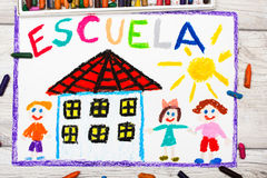 Photo of  colorful drawing - Spanish word SCHOOL. Photo of  colorful drawing: Spanish word SCHOOL, school building and happy children. First day at school Stock Photos
