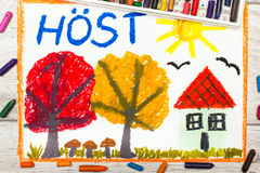 Of colorful drawing: Swedish word Autumn, house and trees with orange and red leaves Royalty Free Stock Photography