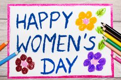 Drawing: Women`s Day card on wooden background. Photo of colorful drawing: Women`s Day card on wooden background Stock Photography