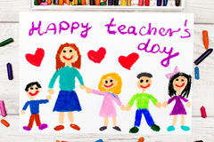 Photo of colorful drawing: Words HAPPY TEACHER`S DAY. Teacher and happy children Stock Photography