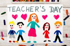 Photo of  colorful drawing: Words TEACHER`S DAY,. Teacher and happy children Royalty Free Stock Photo