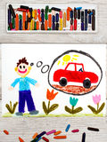 Drawing: young man dreaming about new red car. Photo of colorful drawing: young man dreaming about new red car royalty free stock images