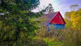 Colorful wooden cabin in the woods stock photos