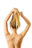 Photo of combing woman with long blond hair Royalty Free Stock Photo