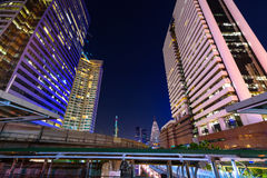 Photo of commercial office buildings exterior. Night view at bot Stock Photo