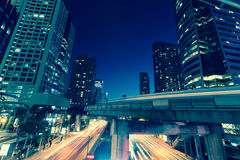 Photo of commercial office buildings exterior. Night view at bot Stock Photos