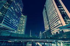 Photo of commercial office buildings exterior. Night view at bot Stock Image
