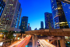 Photo of commercial office buildings exterior. Night view at bot. Tom skyscrapers with light of traffic rush, long exposur in Bangkok Stock Photography