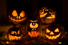 Photo composition from five pumpkins on Halloween. Stock Image