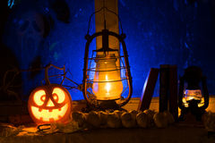 Photo composition for Halloween from mad pumpkin, an oil lamp an Royalty Free Stock Images