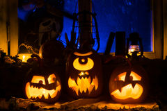 Photo composition from three pumpkins on Halloween Stock Photos