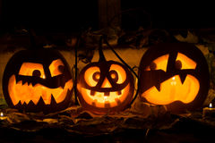 Photo composition from three pumpkins on Halloween. Stock Photos