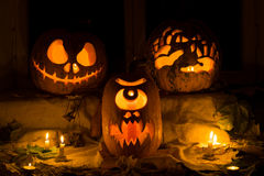 Photo composition from three pumpkins on Halloween. Stock Photography