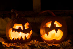 Photo composition from two pumpkins on Halloween. Stock Images