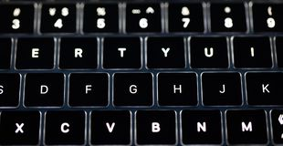 Photo of computer keyboard clavier Backlit keyboard. This is a photo of computer keyboard.with some light around it.The backlit keyboard also makes a welcome stock photos