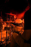 Drummer on concert. Photo of concert stage with the drums in focus royalty free stock images