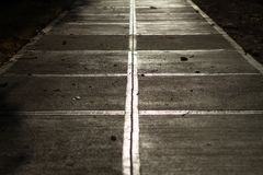 A Sidewalk at Sunset. This is a photo of a concrete sidewalk during the golden hour at sunset Royalty Free Stock Image