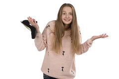 Photo of confused teenage girl with the shoe Stock Image