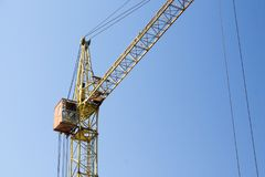 Photo of construction crane against a blue sky background stock photo