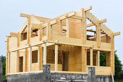 Сonstruction of houses from glued beams laminated beam. Royalty Free Stock Photo