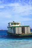 Photo of Container Ship heading off in Maldive Stock Photos