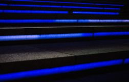 A cool futuristic looking staircase with blue lighting. A photo cool futuristic looking staircase with blue lighting, taken at night stock images