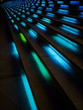 A cool futuristic looking staircase with blue lighting. A photo cool futuristic looking staircase with blue lighting, taken at night royalty free stock photo