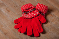 Photo of cool warm gloves on the wonderful brown wooden  Stock Photos