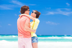 Photo of couple in bright clothes hugging on Stock Photography