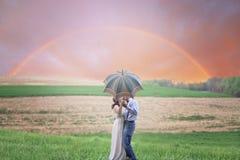 Photo of Couple Holding Umbrella While Kissing Royalty Free Stock Image