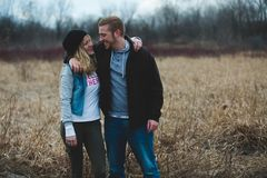 Photo of Couple Near the Field Stock Photography