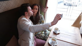 Photo of Couple taking selfie at cafe stock video footage
