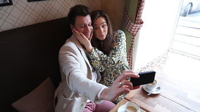Photo of Couple taking selfie at cafe stock video