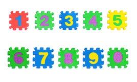 Photo courante : Blocs constitutifs en plastique empilés colorés de jouet Images libres de droits