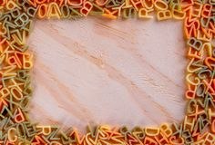Photo created from pasta in the form of a letter - pasta, for inscription royalty free stock images