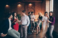 Photo of crowd of working people engaged in business having corporate party with fun and alcohol wearing formally