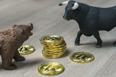 Cryptocurrency Bitcoin price with bull and bear trend concept stock images