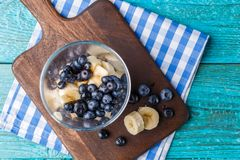 Photo of cup of blueberries and chopped banana Stock Images