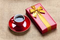 Photo of cup of coffee and cute wrapped gift on the wonderful br Royalty Free Stock Photography