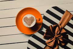 Cup of coffee and gift royalty free stock photography