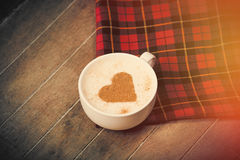 Photo of cup of coffee and tablecloth on the wonderful brown woo Royalty Free Stock Photos
