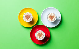 Photo of cups. Cups of coffee on the green background Royalty Free Stock Image