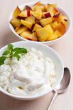 Photo of curd dessert with peaches and mint leaf Stock Image