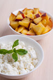 Photo of curd dessert with peaches and mint leaf Stock Photo