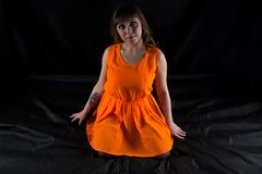 Photo of curvy woman in orange dress Royalty Free Stock Photography