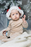 Photo of cute baby in Santa hat Royalty Free Stock Image