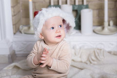 Photo of cute baby in Santa hat Royalty Free Stock Photos