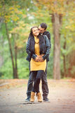 Photo of cute couple hugging and smiling on the wonderful autumn Stock Images