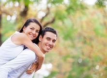 Photo of cute couple hugging on the wonderful autumn park backgr Royalty Free Stock Photos
